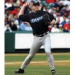 Toronto Blue Jays (2004) Roy Halladay fires to first wearing the Toronto Blue Jays alternate uniform in 2004