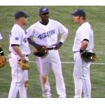 Toronto Blue Jays (2005) Orlando Hudson, Eric Hinske, and Shea Hillenbrand chat during a break in play wearing the Toronto Blue Jays home uniform with graphite cap and tri-memorial patch on sleeve