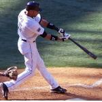 Toronto Blue Jays (2005) Alex Rios swings at a pitch wearing the Toronto Blue Jays home uniform with tri-memorial patch in 2005