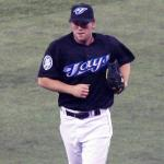 Toronto Blue Jays (2006) Casey Janssen runs off the field wearing Toronto Blue Jays alternate uniform with 30th anniversary patch on sleeve