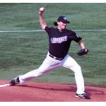 Toronto Blue Jays (2006) Vinnie Chulk throws a pitch while wearing the Toronto Blue Jays black and red Canada Day jerseys in 2006