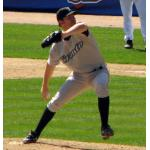 Toronto Blue Jays (2007) Casey Janssen throws a pitch wearing the Toronto Blue Jays road uniform and T cap in 2007