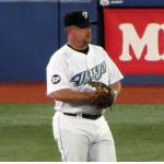 Toronto Blue Jays (2007) Matt Stairs wearing Toronto Blue Jays home uniform with Sam Pollock memorial patch on sleeve in 2007
