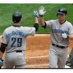 Toronto Blue Jays (2008) Adam Lind and Dustin McGowan celebrate after a home run wearing the Toronto Blue Jays road uniform in 2008