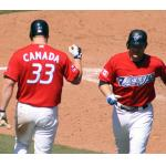 Toronto Blue Jays (2009) Scott Rolen and Adam Lind celebrate a home run wearing the Toronto Blue Jays red Canada Day uniforms in 2009