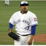 Toronto Blue Jays (2009) Ricky Romero leaves the mound wearing the Toronto Blue Jays Back 2 Back World Series reunion throwback uniforms in 2009, note the Back 2 Back Champions patch on the sleeve.