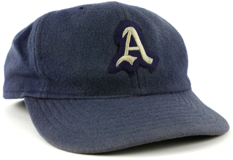 Philadelphia Athletics Game-Worn Cap Photo Cap Photo (1931-1949) - Photo of a Philadelphia Athletics game worn blue cap with white A. This style of design was worn by the team on the road from 1931-1941 and for home and road games from 1942-1949. SportsLogos.Net