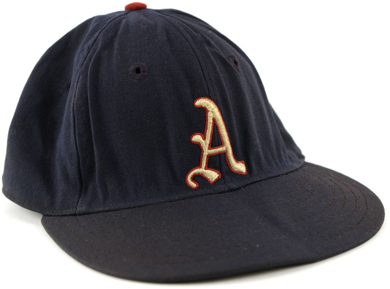 Philadelphia Athletics Game-Worn Cap Photo Cap Photo (1954) - Photo of a Philadelphia Athletics game worn blue cap with white A outlined in red. This style of design was worn by the team in 1954, their final season in Philadelphia SportsLogos.Net