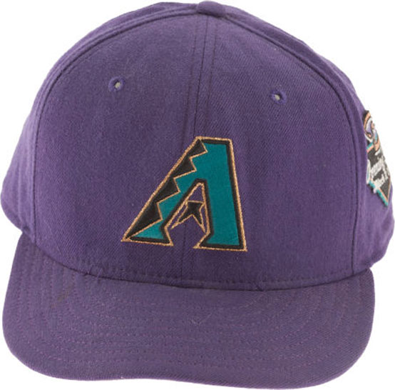 Arizona Diamondbacks Game-Worn Cap Photo Cap Photo (1998-2006) - Arizona Diamondbacks game worn home cap, style worn from 1998 through 2006. This photograph shows the Opening Game patch from the 1998 season, note that this patch was only worn on March 31, 1998 and never again. SportsLogos.Net