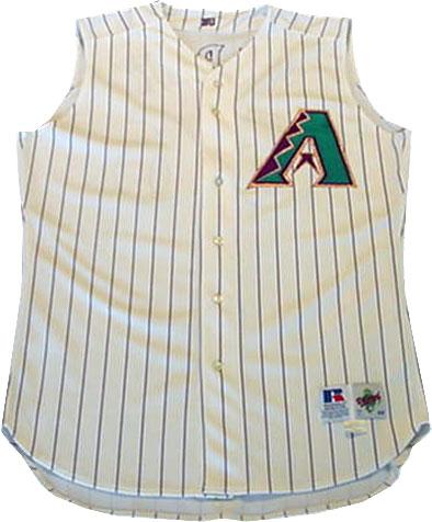 Arizona Diamondbacks Game-Worn Jersey Photo Jersey Photo (1998-2006) - Game worn Arizona Diamondbacks sleeveless cream alternate jersey, this vest was paired with a purple undershirt. Style worn from inaugural 1998 season through the end of 2006. SportsLogos.Net