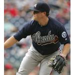 Atlanta Braves (2011) Kris Medlen wearing the Atlanta Braves alternate blue uniform with Ernie Johnson memorial patch during a game in 2011 season