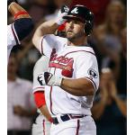 Atlanta Braves (2011) Dan Uggla wearing the Atlanta Braves home white uniform with Ernie Johnson memorial patch during a game in 2011 season