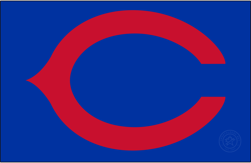 Chicago Cubs Logo Cap Logo (1940-1956) - Red wishbone C on a royal blue field. Worn on Chicago Cubs caps from 1940-1956. SportsLogos.Net