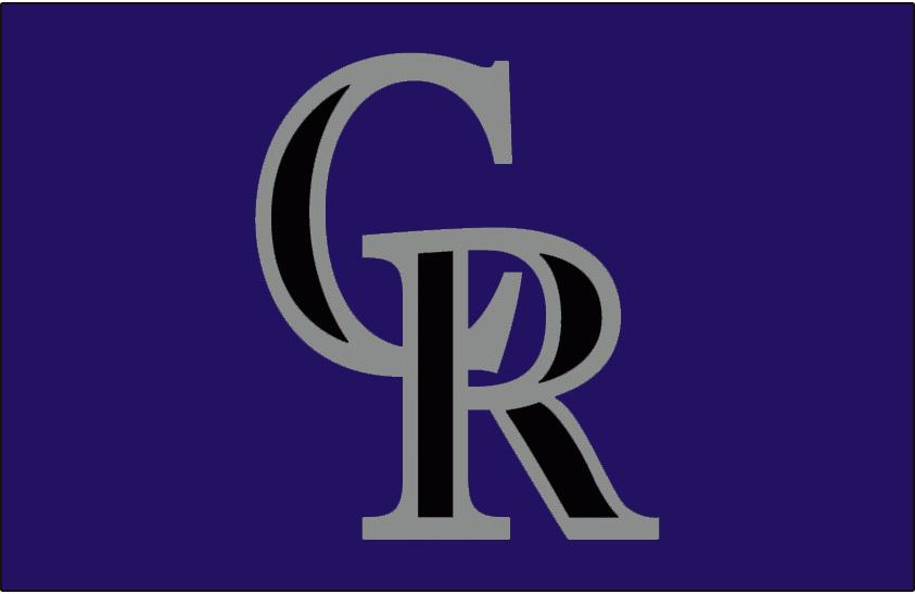 Colorado Rockies Logo Cap Logo (2003-2012) - A black interlocked CR with a silver outline on purple. Worn on the rarely-seen Colorado Rockies alternate purple caps starting in 2003. SportsLogos.Net
