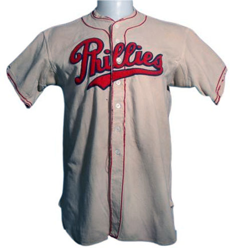 Philadelphia Phillies Game-Worn Jersey Photo Jersey Photo (1935-1937) - Game worn Philadelphia Phillies home jersey - Phillies in red script with blue outline, red piping down front of white jersey. This style was worn from 1935-1937 SportsLogos.Net