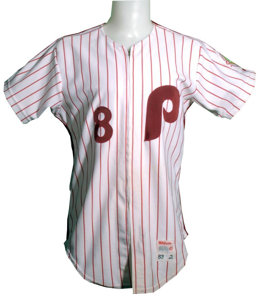 Philadelphia Phillies Game-Worn Jersey Photo Jersey Photo (1973-1986) - Game worn Philadelphia Phillies home jersey - a maroon P on a white jersey with red pinstripes. This style was worn from 1973-1986, this particular jersey was worn in 1983 (Phillies 100th anniversary patch on sleeve) SportsLogos.Net