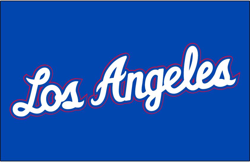Los Angeles Clippers Logo Jersey Logo (2012/13) - Los Angeles in white script with red trim on blue, worn on LA Clippers alternate jersey in 2012-13 season SportsLogos.Net