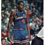Kansas City Kings (1977) Sam Lacey wears the Kansas City Kings road uniform with captains C on chest on his 1977-78 Topps basketball card