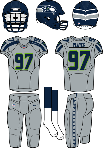 Seattle Seahawks Uniform Alternate Uniform (2012-Pres) - Navy helmet (primary logo wraps around the back) with gray jersey (accented in navy) and gray pants. Manufactured by Nike. SportsLogos.Net