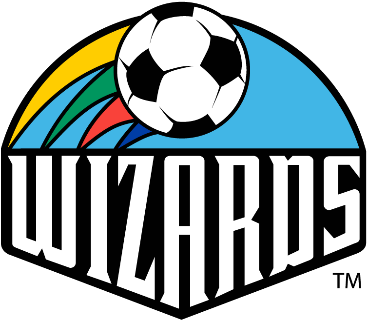 Kansas City Wizards Logo Primary Logo (1997-1999) - WIZARDS in white under a light blue semi circle, a soccer ball flying by with yellow, green, red, and blue trails SportsLogos.Net
