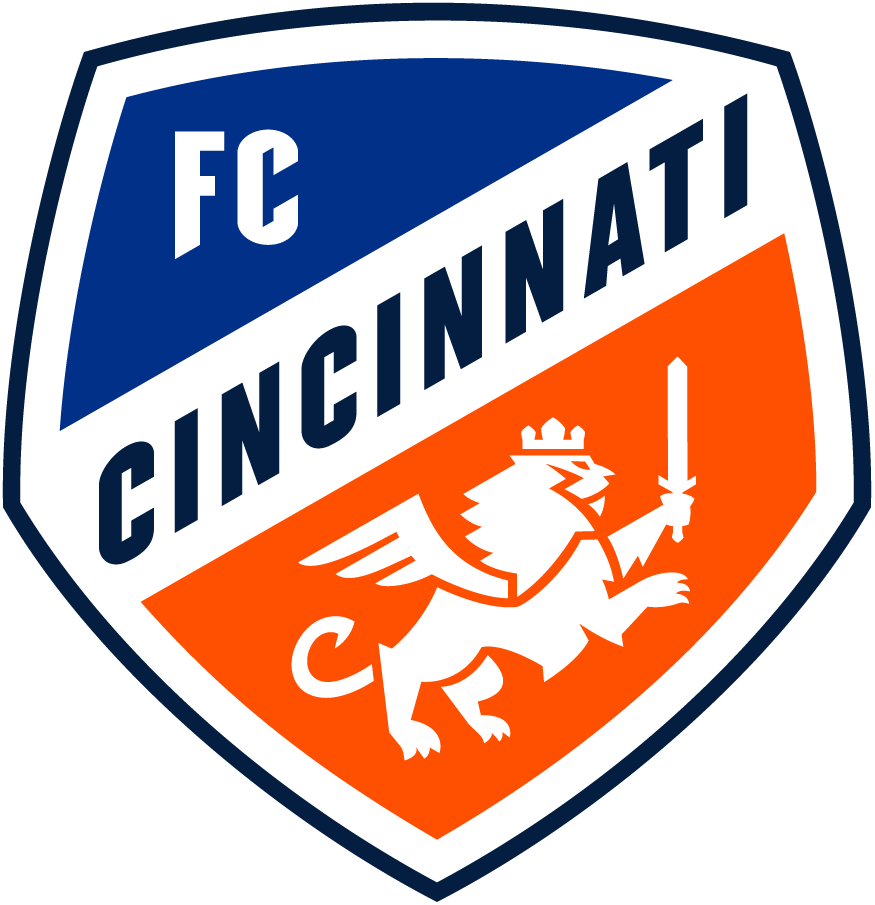 FC Cincinnati  Logo Primary Logo (2019-Pres) - A lion holding a sword and wearing a crown inside a blue and orange shield, representing Cincinnati's Queen City nickname SportsLogos.Net