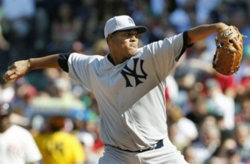 Ivan Nova in a grey and blue Yankees cap during a 1912 throwback game in 2012