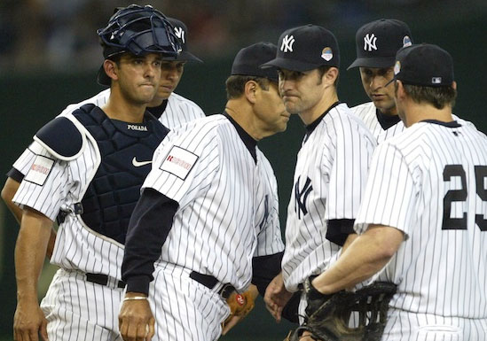 "The New York Yankees wearing a ""Ricoh"" sponsor patch during a regular season game in 2004"