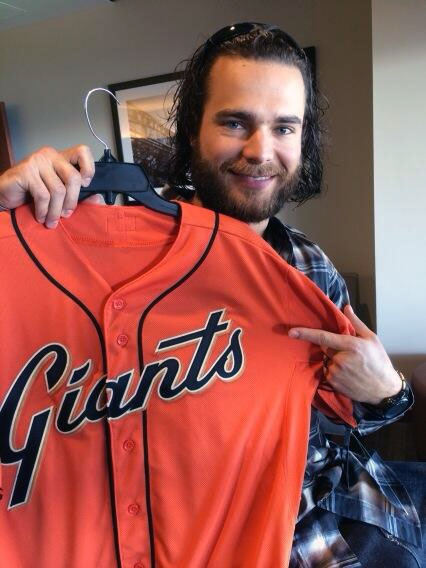 Brandon Crawford shows off the new orange alternate jersey for 2014