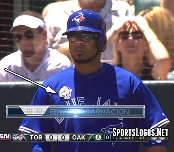 Encarnacion's Lou Gehrig patch starting to fall off in the Top of the 1st