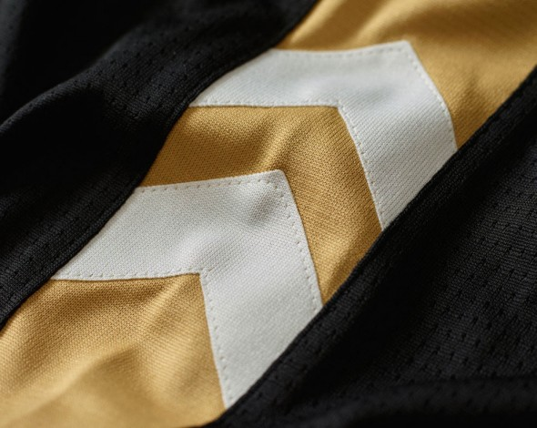 Two chevrons on the side of every jersey, pointing up to the north