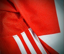Three Adidas stripes on Team Canada jersey