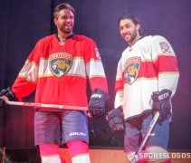 Panthers players Aaron Ekblad and Vincent Trocheck model the new uniforms