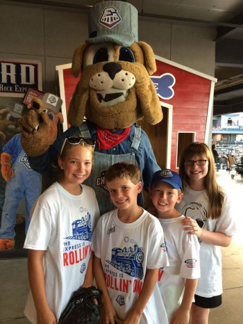 Mascot Spike (like a railroad spike) with fans at a game.