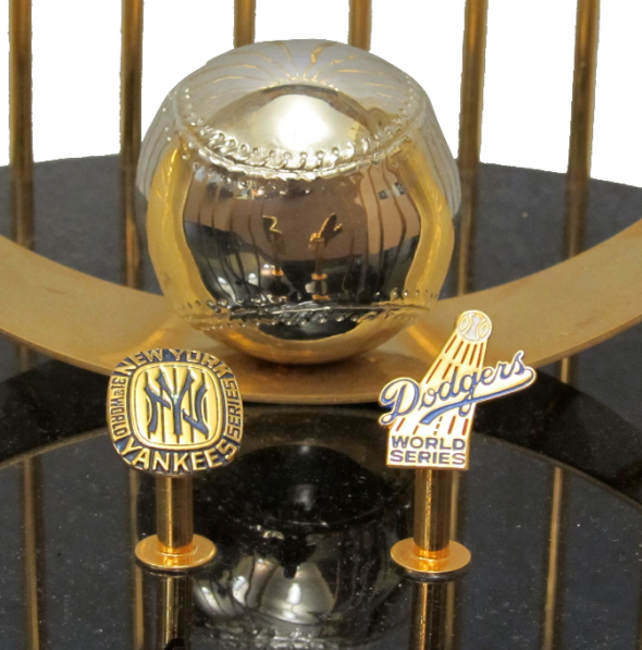 Press pins for the New York Yankees and Los Angeles Dodgers on the 1977 World Series trophy