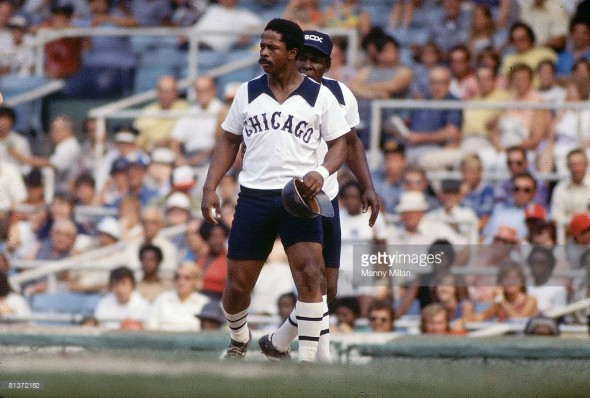 Ralph Garr at first base with coach Minnie Minoso wearing the shorts in August 1976
