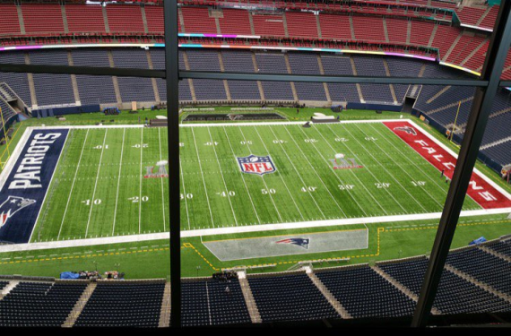 Super Bowl LI field is painted and patches are applied to jerseys