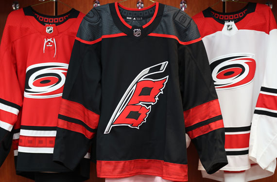 Carolina was the first club to unveil an official third uniform here in  NHL s Adidas era. The Hurricanes went back to black for their alternate  look ... b59ebf2dfe8