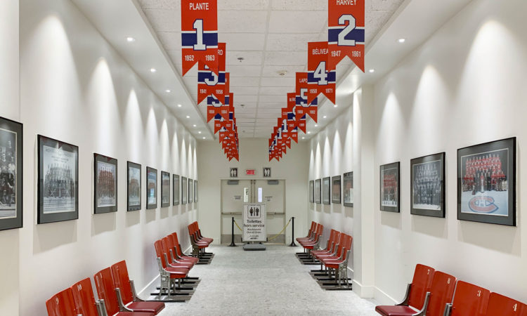 Original Forum seats, replica banners, team photos line the hallway to the restrooms